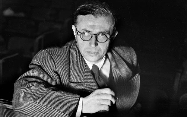 Satre At The Theatre...French philosopher Jean-Paul Sartre at a production of his play 'La Putain Respectueuse' (The Respectful Whore) at the Theatre Antoine in Paris, November 1946. (Photo by Lipnitzki/Roger Viollet/Getty Images)
